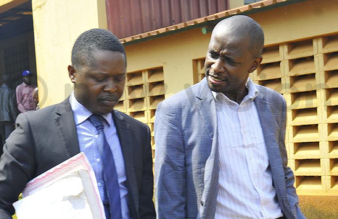 llan ariyo left with his client aymond agimba ugimba after appearing at akawa ourt hoto by ilfred anya