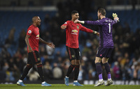 Football: United win feisty Manchester derby