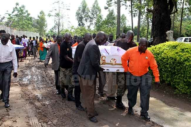 he casket containing the body of ynette tim abunya being carried to her carried to her grave hoto by udson punyo