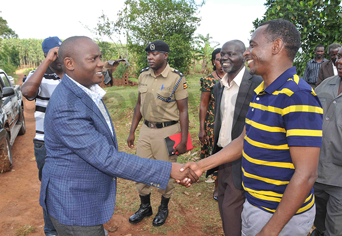senyonga welcomes minister onald ibuule left upon arrival for the ceremony hoto by enry subuga