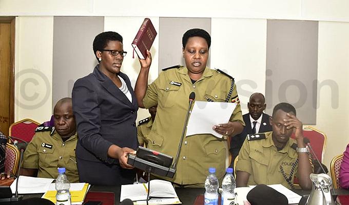 essica eigombe taking oath before she faced the committee hoto by aria amala