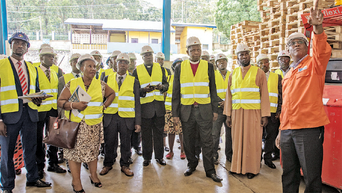 kamabare right taking religious leaders around the warehouse in entebbe during the 25 years celebrations recently