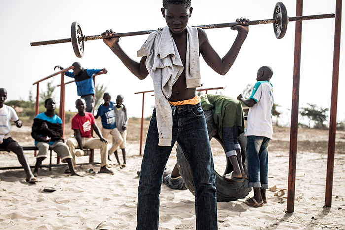oung street children also referred to as alibe play with weights in a quarantined area at a refuge for newly arrived street children outside akar on pril 10 2020 hotos by