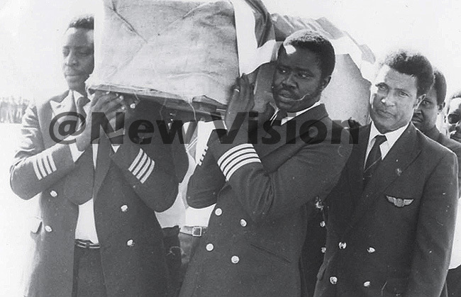 ganda irlines pilots carry the casket containing alusimbis remains