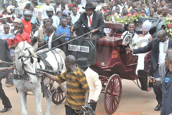 he couple is driven by horse carriage after they tied the knot at ubaga athedral