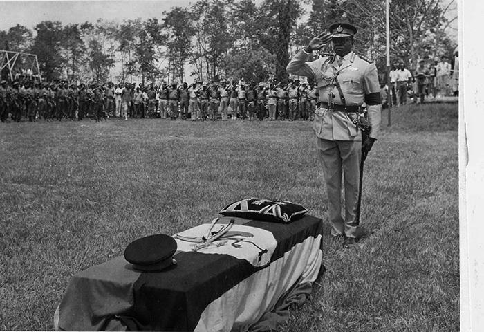 resident di min salutes the body of abaka utesa  during his funeral hotoile