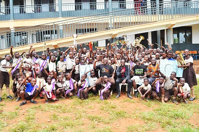 isan segawa and ulius amugera  with the pupils of isada assion rimary chool ombo alule in uwero district during their visit to the school on arch 12
