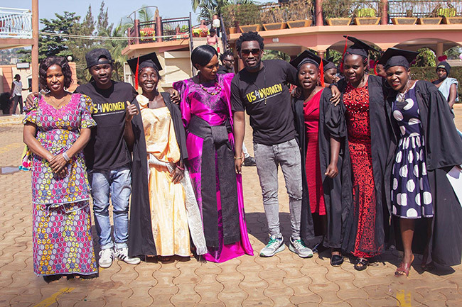 evixone and rinity pose with the women after their graduation through the 4 programme