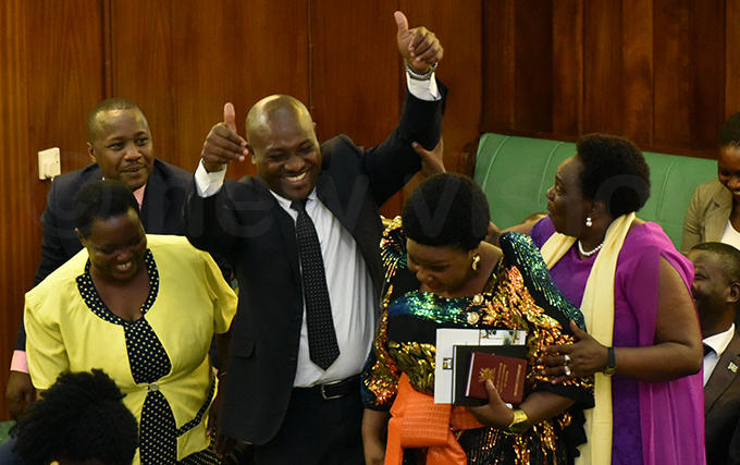 usinge is congratulated by fellow s after she was sworn in hoto by iriam amutebi