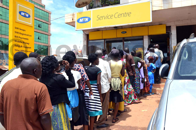 eople queue for registration of  cards at  offices on ukono ouse in ukono hoto by rake sentongo