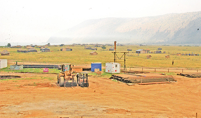 camp being set up by oil exploration workers in the lbertine region