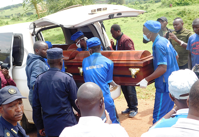 wandan authorities handing over the bodies of gandans on uesday allegedly killed while smuggling goods across the border hoto by ob amanya