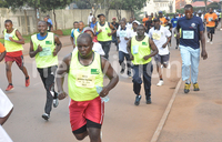 Employees participate in Occupational Safety and Health run