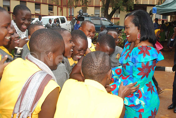 ampala apital ity uthority  xecutive irector ennifer usisi right interacting with some of the students of akerere ollege during her visit to the school usisi commissioned an administration block at the school that was constructed by  his was on ctober 31 2018 hoto by awrence ulondo