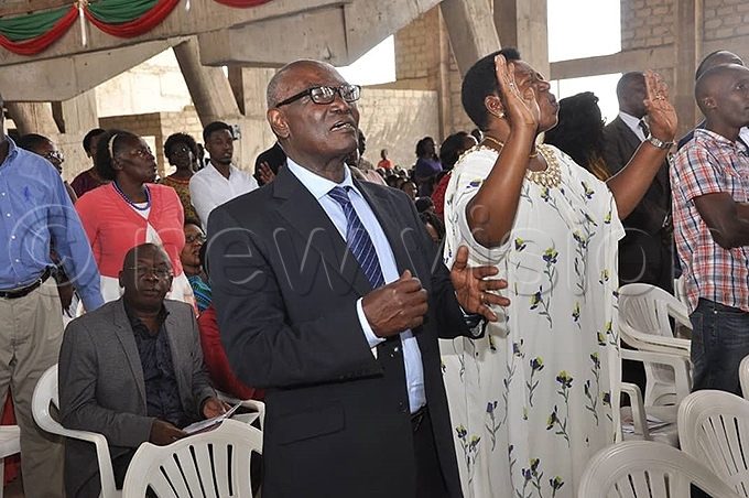 iria atembe and husband ekemia atembe during the hristmas service at ll aints athedral hoto by uliet asirye