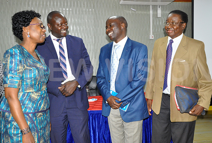 inister of ealth ane uth ceng interacting with some of the researchers who conducted the study about sickle cell disease from left r hillip asirye r obert poka and rof hristopher dugwa
