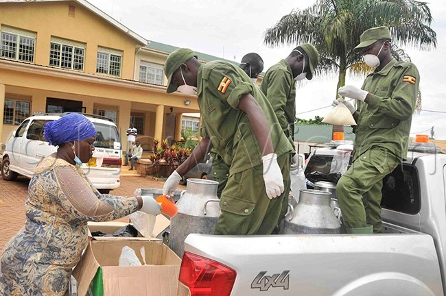 he ocal efense nit officers packing the milk before handing it over to the sick people and their attendants