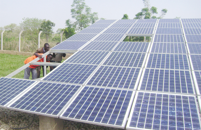 fficials inspecting solar panels ganda is exploring other sources of renewable energy such as solar energy