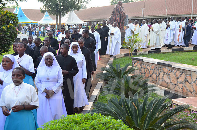 atholic priests seminarians and nuns in procession for the memorial prayers of ardinal subuga at apeera akateyambas ome alukolongo on aturday