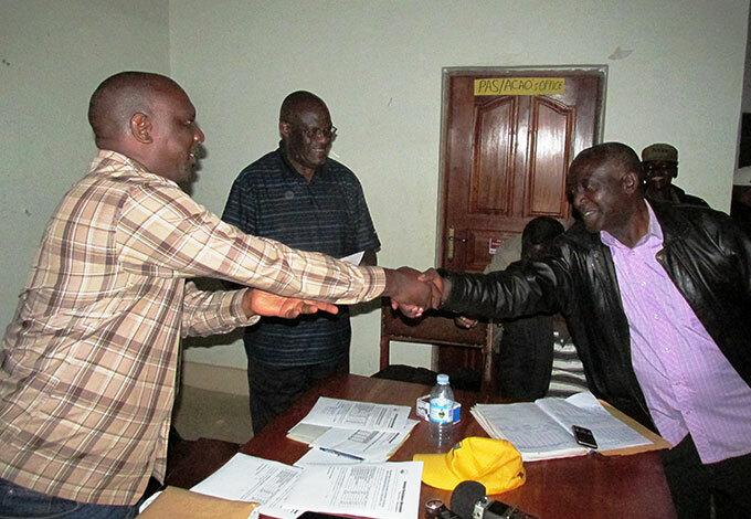 officials congratulating r lexander ampikaho