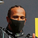 Three-wheel Hamilton wins British Grand Prix