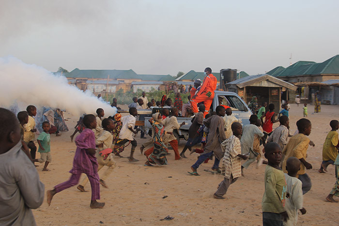 hildren playfully run away from a fumigation machine mounted on the back of a pick up used in a displaced camp in aiduguri on pril 15 2020 as the orno tate nvironment rotection gencys  proceeds to disinfect the camps as a preventive measure against the spread of 19 coronavirus   hoto by