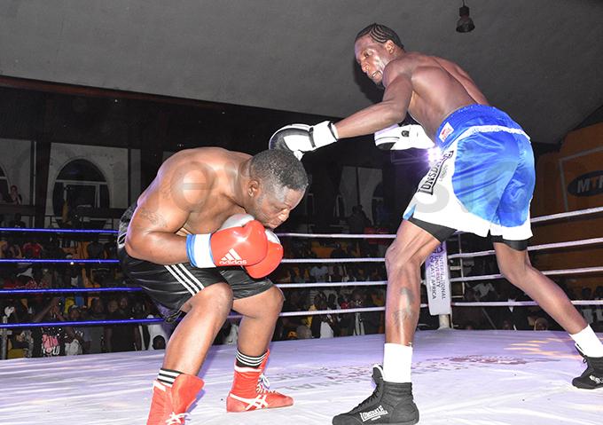 bikayi ducks a jab from hafik iwanuka during the short lived fight hoto by ohnson ere