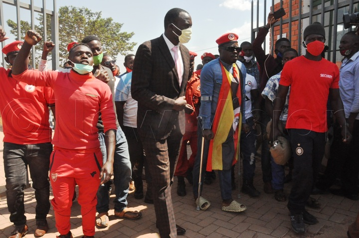 Supporters escort Zaake in Mityana after attending a court session