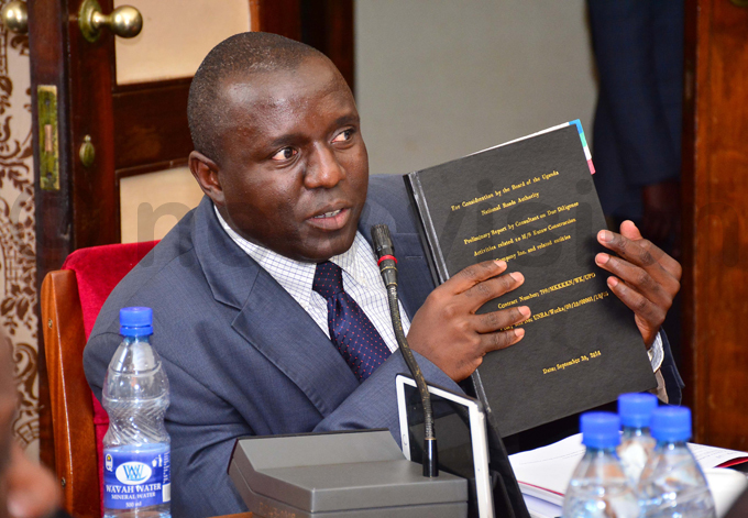 emwogerere shows the only copy of the report he made when he travelled to  to do research on  hoto by iriam amutebi
