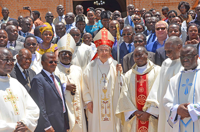 he postolic uncio to ganda uigi ianco rchbishop yprian izito wanga state minister ohn hrisostom uyingo and other hristians after the aster mass at ubaga athedral hoto by athias azinga