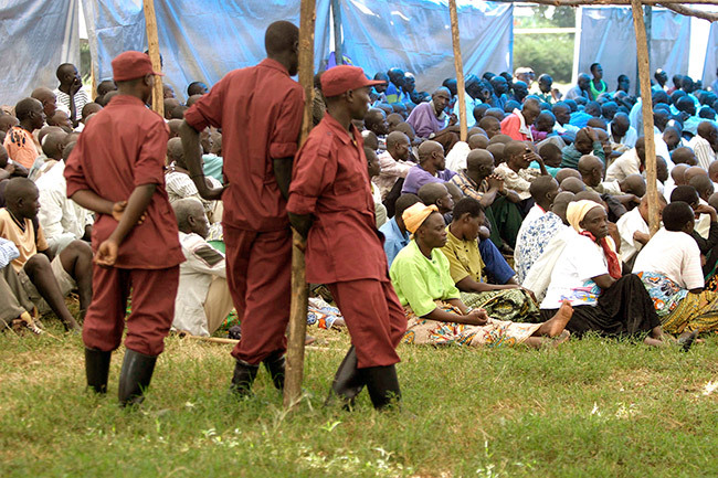 n this file photo taken on ugust 29 2005 wandan prisoners accused of acts of genocide attend a reconciliation class under the surveillance of wandan policemen in a olidarity amp in ayonza town one day before being released