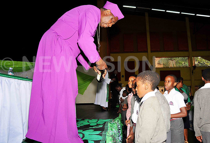 is race tanley tagali blessing ampala arents chool rimary seven pupils  during the candidates dedication prayers ceremony at ampala arents school ahead of their rimary eaving examinations  hoto by arim sozi