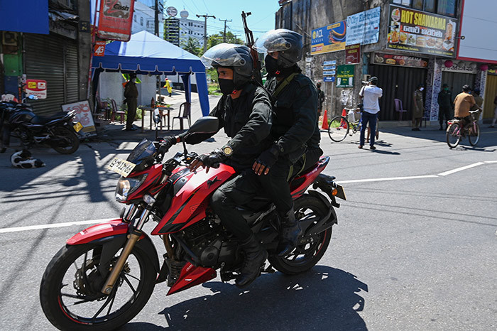 oldiers ride on a motorbike as they patrol along a street during a governmentimposed nationwide lockdown as a preventive measure against the spread of the 19 coronavirus in eruwala on pril 16 2020 hoto by akruwan