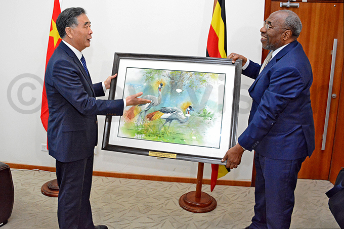 ang ang received a crested crane painting to symbolise the peaceful relationship between the two countries hoto by iriam amutebi