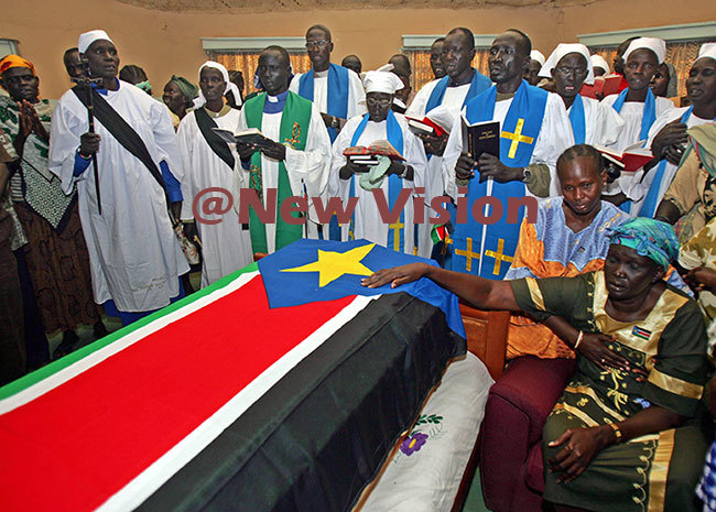 r arangs funeral in 2005 ouching his coffin is his wife ebecca