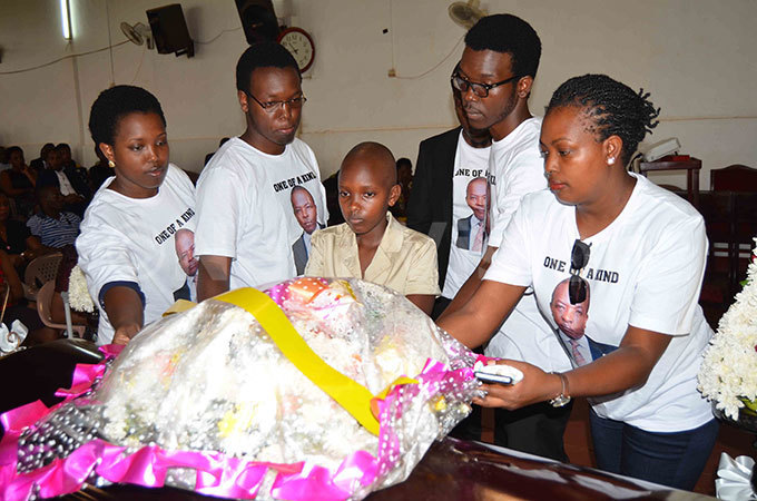 hildren of the late eoffrey wakishumba placing a wreath on the casket that contains his remains hoto by athias azinga