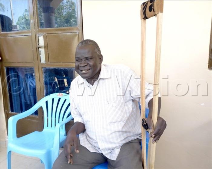 MP Wadri Kasiano Ezati holding his walking stick during a press briefing on Saturday. Photo By Robert Ariaka