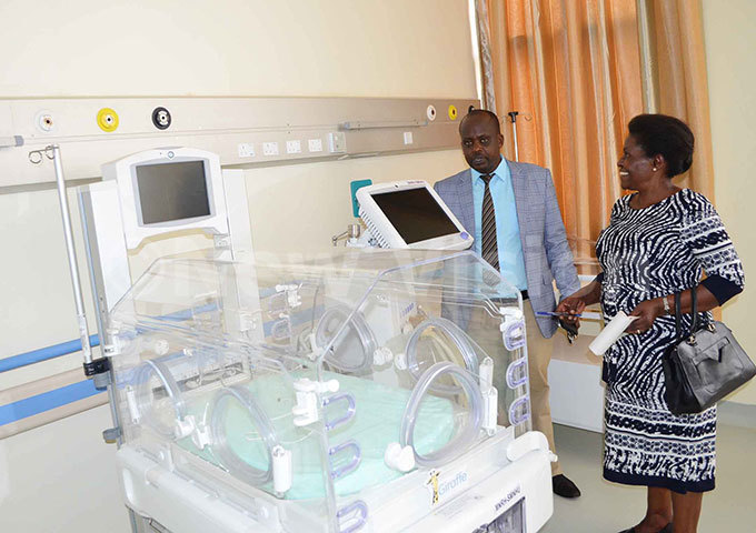 he acting assistant director of ulago pecialised omen and eonatal hospital r olly ankunda also a paediatric consultant and ulago ospital spokesperson nock usasira in one of the eonatal ward hoto by iolent abatanzi