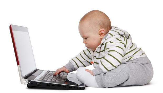 babyworkingonalaptop100689513orig