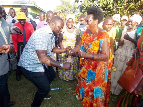 doa dancing with an official from  ecretariat to celebrate the appointment as minister on onday hoto by mmanuel lomu