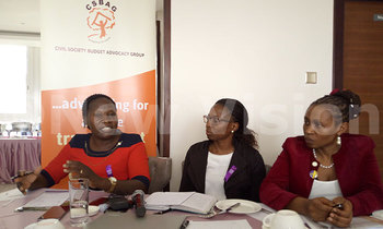 Left to right bigirwa norah buliisa district woman mp speaking during a dialogue on financing towards eliminating gbv as sophie nampewo of csbag centre as tina musuya of cedovip look on 1 350x210