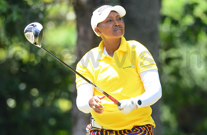 ddi adina watches her drive in the second round of the  tournament at the ntebbe course ctober 25 2019 hoto by ichael subuga