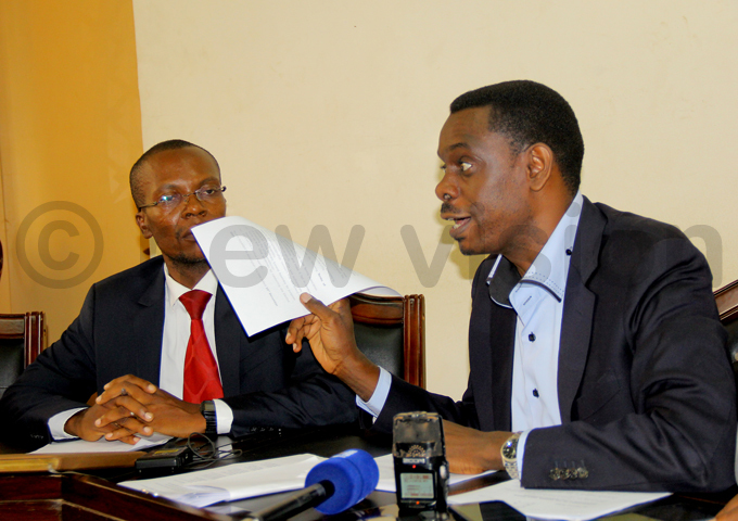 aggwe displays a copy of the court ruling hoto by ohnson ere