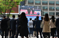 'No longer a hermit': South Koreans fascinated by Kim