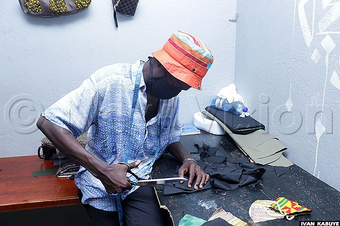 ulondo ustafa cutting a cloth to make masks