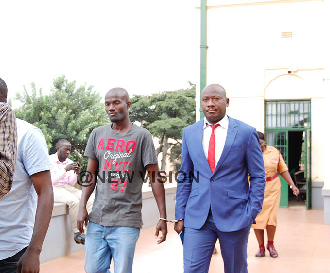 eoffrey ubwama left and onald utebi after being convicted of robbery and murder of  ndrew atare a olombia niversity student at igh court in ampala hoto by ylvia atushabe