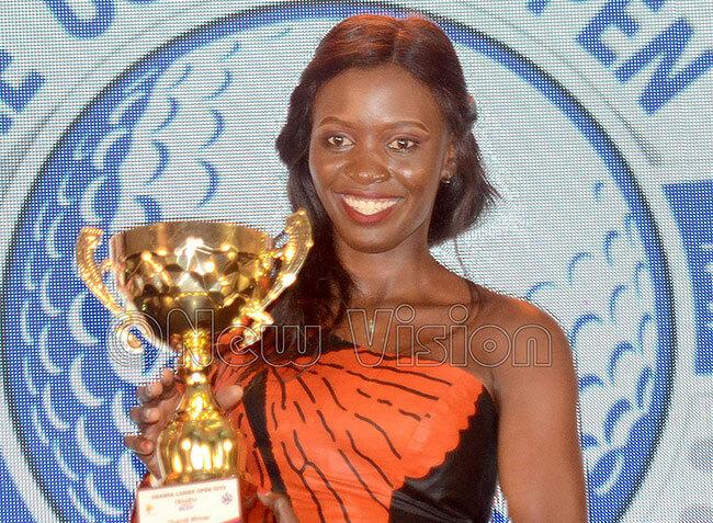 ganda adies pen champion abirye poses with her trophy