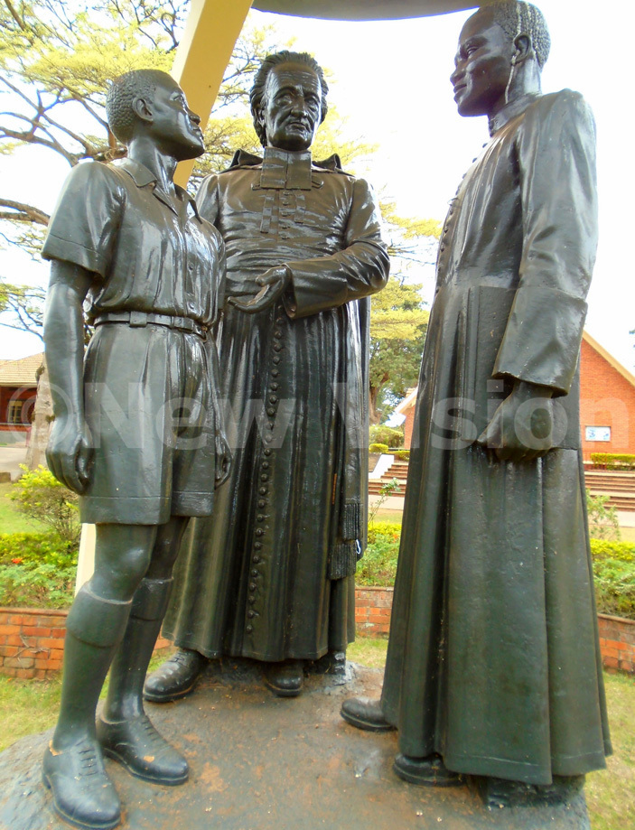 statue of ather ean arie de la ennais with an frican student and an frican atholic