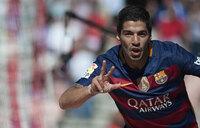 Suarez outguns Messi, Ronaldo to fire Barca to title