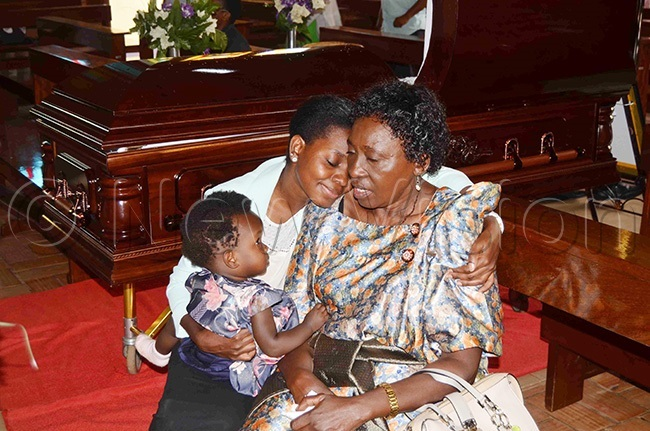 he widow eronica dumba being consoled by a relative during the requiem mass